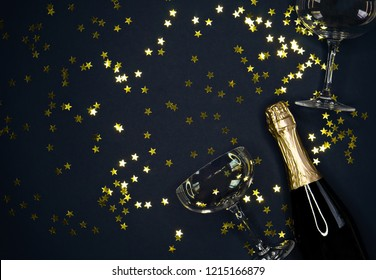 image of champagne coupes and  bottle on dark blue  background