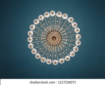 The image of the chandelier in the style of Art Nouveau.  Unique classical empire chandelier. Modern style background for a monitor.