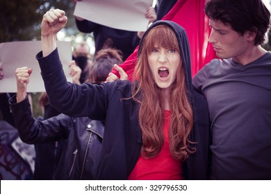 Image of chanted female protester with raised fist