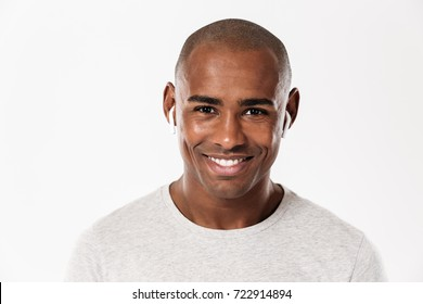 Image of cheerful young african man standing isolated over white background. Looking camera.