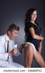Image of cheerful young lovers playing in studio