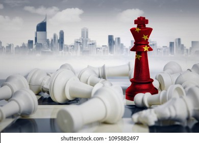 Image of a chess king with China flag defeating white chess pieces. Shot with modern city