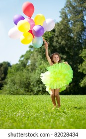 The image of a child with a bunch of balloons in their hands