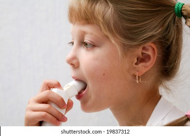 An image of a child making inhalation