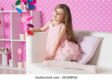 The image of child in the nursery in pink dresses