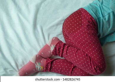 Image of child pee on the mattress.Girl wet the bed while she was sleeping,Bedwetting ,Child pee on a mattress,Little girl feet and pee in bed sheet,Child development concept