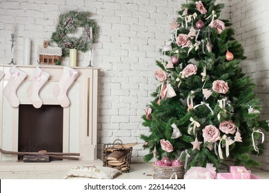 Image of chimney and decorated xmas tree with gift