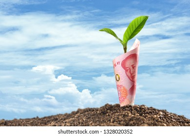 Image of China Yuan banknote with plant growing on top for business, saving, growth, economic concept
