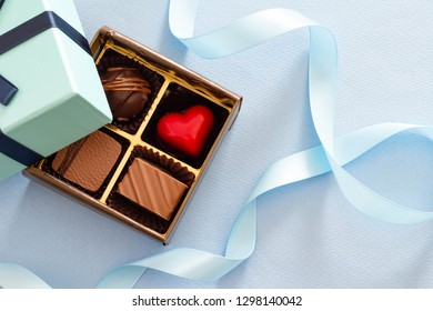 Image of chocolate and blue box and ribbon Valentine's gift