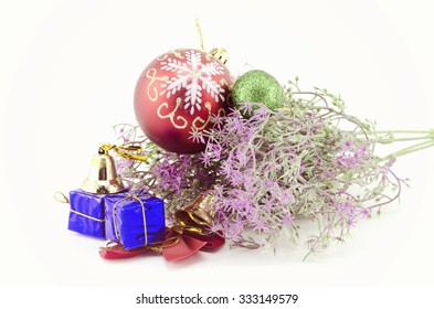 image of Christmas decorations with red ball,green ball,red ribbon, gift, bell and artificial flower isolated on white background