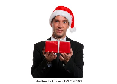 Image of christmas man in business suit, , Santa cap with gifts in box