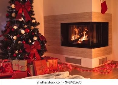 Image of christmas tree in living room with fireplace