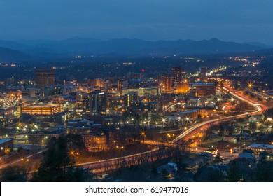 Image of city skyline at night Asheville, NC.