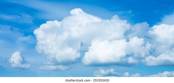 image of clear sky with white clouds on day time for background usage .