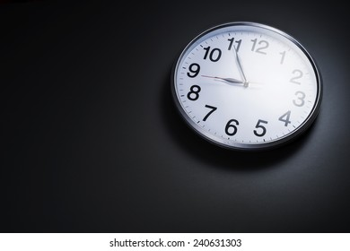 Image of clock on with left space room for text