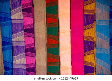 Image close up a lot of adorable beautiful scarf silk fabricated beautifully, scarf Background Wallpaper concept, Chiang Rai, Thailand