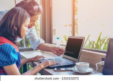 Image close up of couple asia woman using notebook with tablet while relaxing at cafe with matcha cake, Home worker working outside of company concept