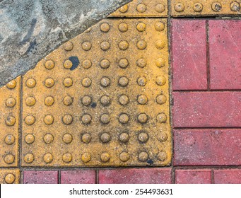 image of close up at Tactile paving texture for blind handicap on the road.