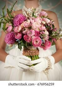 Image closeup of bride holding a beautiful bouquet