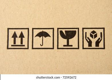 Image close-up of grunge black fragile symbol on cardboard