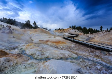Image of clouds seeming to flee the  dangerous steam from  boiling springs and hot mud pots along boardwalk in Lassen Volcanic National Park