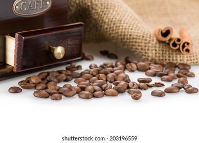 Image of Coffee beans closeup with coffee mill