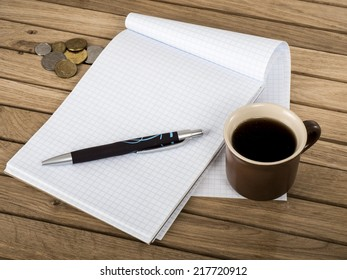 image of coffee cup with notebook and pen.
