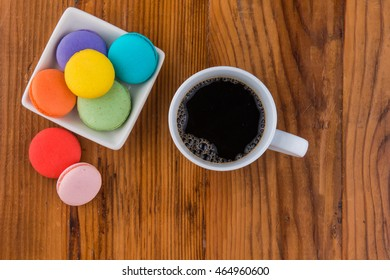 image of coffee and macaroons from above with coffee
