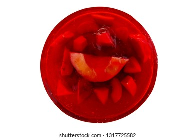image of cold red jelly cake with fruits inside