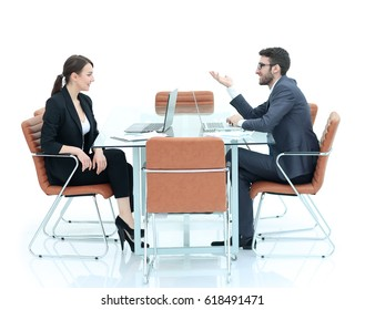 Image of collegues discussing documents and ideas at meeting