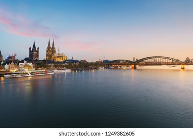 Image of Cologne with Cologne Cathedral with Rhine river and Hohenzollern  bridge during twilight blue hour in Germany.