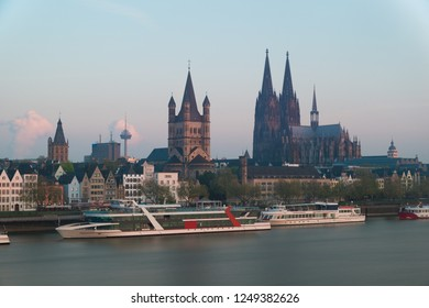 Image of Cologne with Cologne Cathedral with Rhine river during twilight blue hour in Germany.