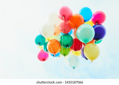 image of colorful balloons with sky background