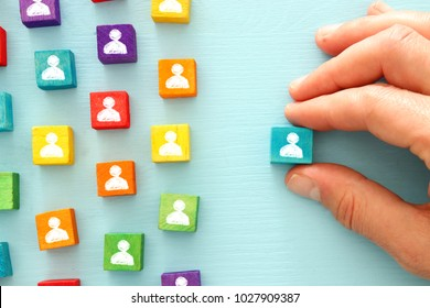 image of colorful blocks with people icons over wooden table ,human resources and management concept