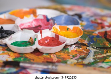 Image of colorful paints on palette for art background