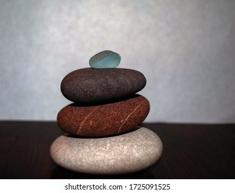 The image of colorful stones from the Black Sea. Pebble stones. Stone balancing. Stones pyramid. Pebbles for meditation.