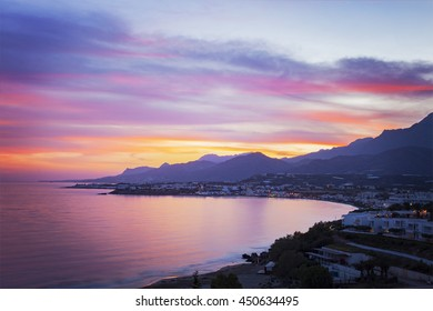 Image of a colourful sunset over the village of Makrigialos on Crete, Greece.
