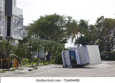 Image of a commercial truck flipped over due to high wind from Hurricane Irma