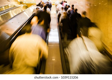 An image of Commuters on escalator