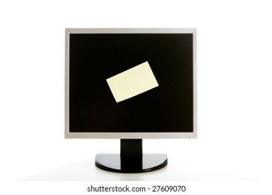 Image of computer monitor with sticky piece of note paper on it
