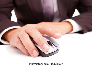 Image of a computer mouse in hand businessman on white