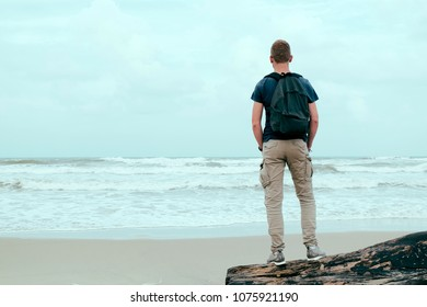 Image concept of leisure, recreation and well being.Lonely man standing on beautiful exotic beach
