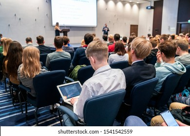 Image of a conference that takes place in a large conference room, workshop for young professionals, training in a large conference room, adult training