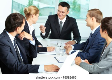 Image of confident boss voicing his ideas at meeting