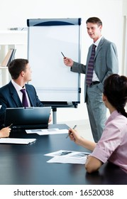 Image of confident businessman doing a presentation at business conference