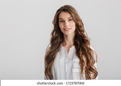 Image of confident caucasian woman posing and looking at camera isolated over white background