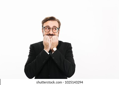 Image of confused businessman standing isolated over white background looking aside.
