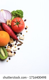 Image consisting of red onions, broccoli, walnuts, red beans, beans, garlic, kiwi, tomatoes, sweet potatoes and oranges.
