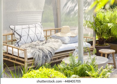 Image of a cozy garden seating area.