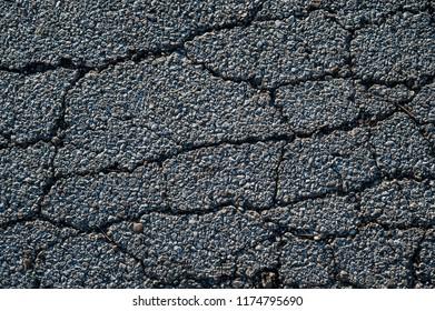 Image of cracks running through aged asphalt
